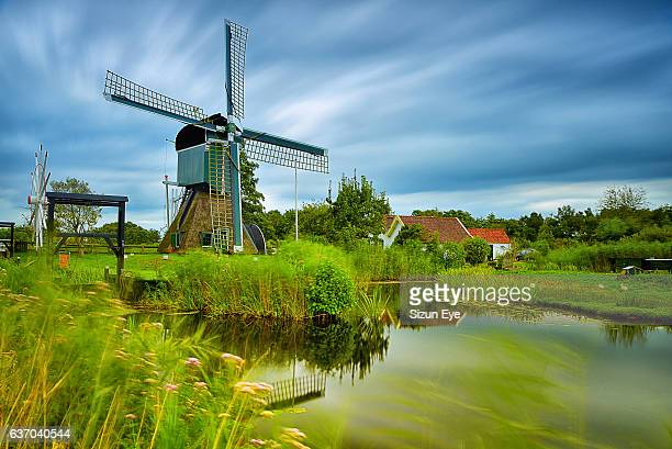 old windmill in the village of tienhoven, netherlands. - traditional windmill stock photos and pictures