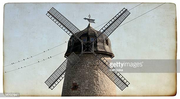 Old windmill on vintage paper