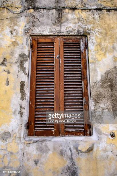 old window in a grunge concrete facade in italy - finn bjurvoll stock pictures, royalty-free photos & images