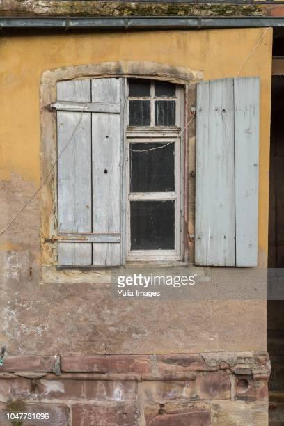 old window with weathered wood shutters - fensterladen stock-fotos und bilder