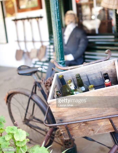 Old wine bottles on a bicycle