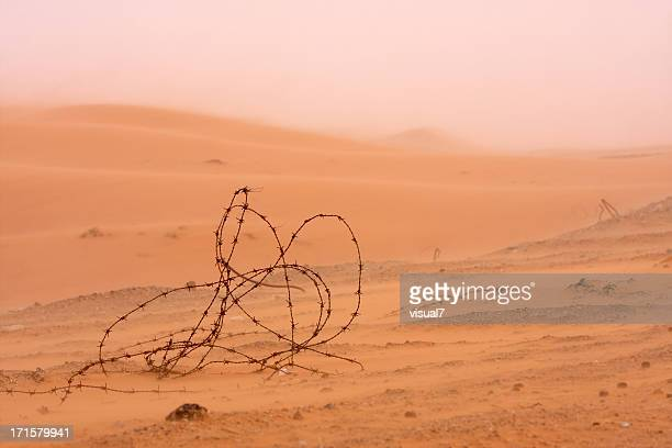 old wire fence in a sand storm near dubai