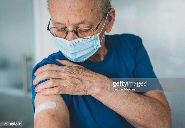 old woman after receiving a vaccine - medical research stock pictures, royalty-free photos & images