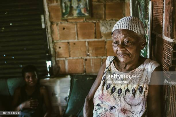 old woman and her grandson at home, rio de janeiro state, brazil - favela stock pictures, royalty-free photos & images