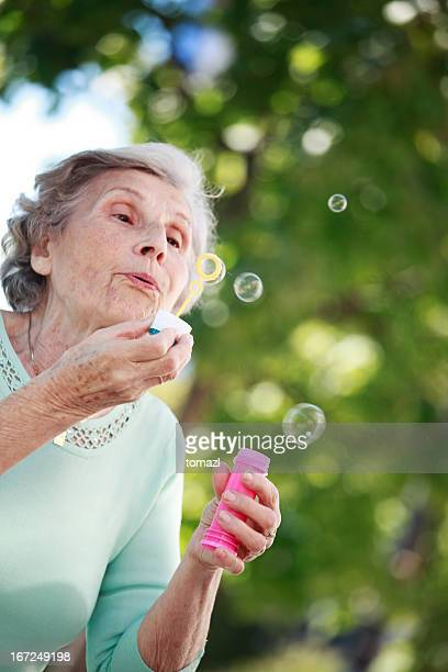 Old woman blowing bubbles