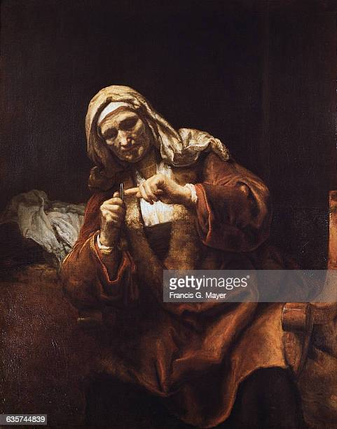 Old Woman Cutting Her Nails by School of Rembrandt