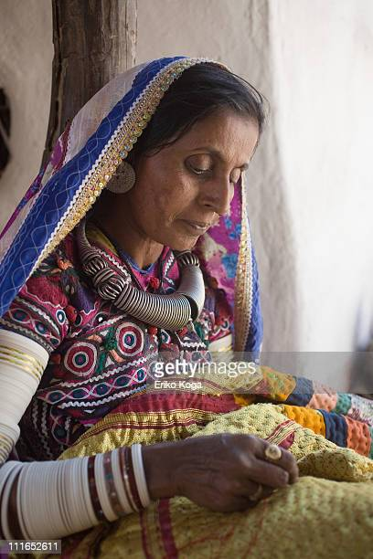 Old woman doing embroidery