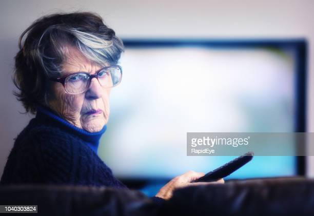 old woman failing to master tv remote is frustrated - anger stock pictures, royalty-free photos & images