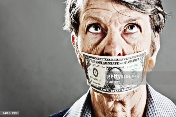 Old woman gagged with US dollar bill rolls her eyes