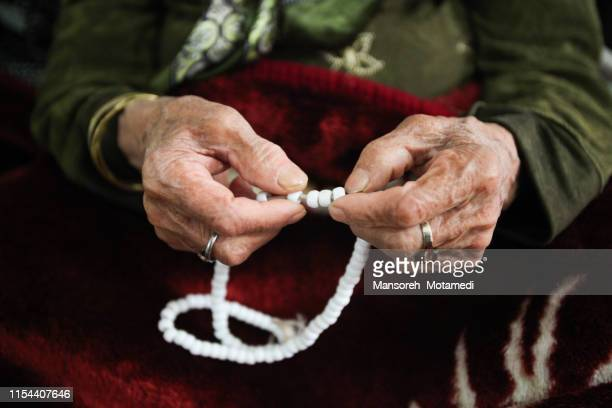 old woman hands - rosary beads stock pictures, royalty-free photos & images