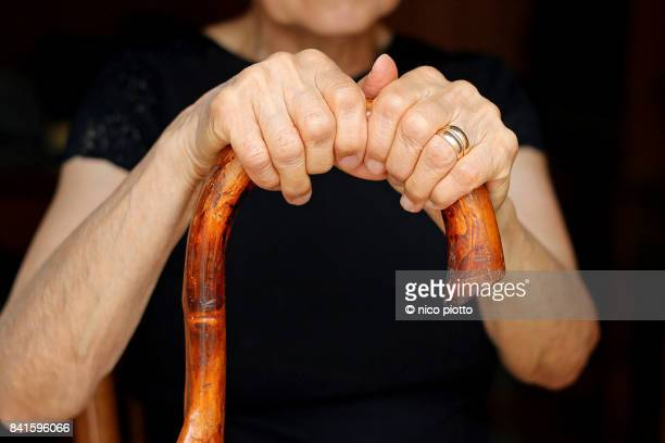 Old Woman holding walking stick