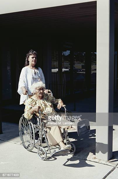 Old Woman In Wheel Chair With Her Daughter