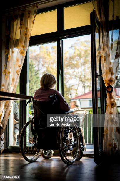 Old woman in wheelchair indoors