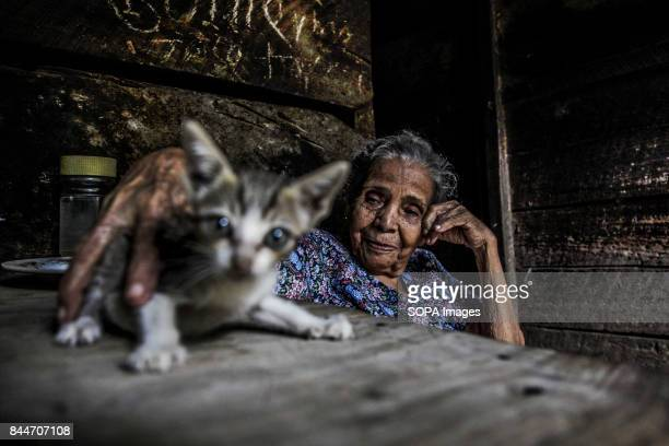 CHICHIGALPA CHINANDEGA NICARAGUA A old woman is pictured with his cat inside her house on the Island of Widowed Women a town that is located within...
