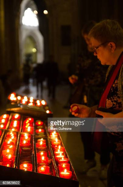old woman lighting candle in the saint mary church - mary moody fotografías e imágenes de stock