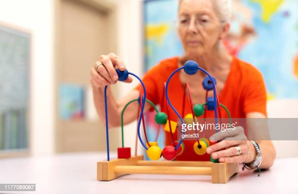 old woman make exercise why she is protected alzheimer's disease - alzheimer's disease stock pictures, royalty-free photos & images