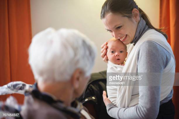 Old woman meeting her great granddaughter