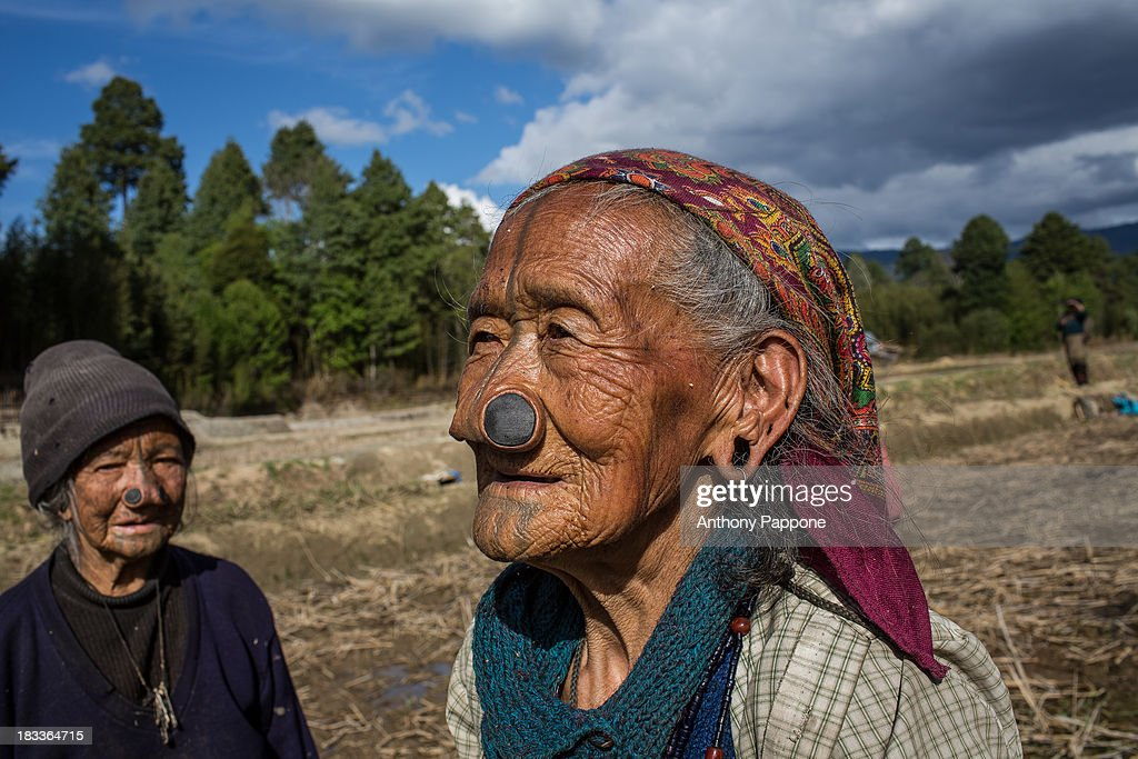 Content Old Woman Of The Apatani Tribe With Nose Pierced To Work In