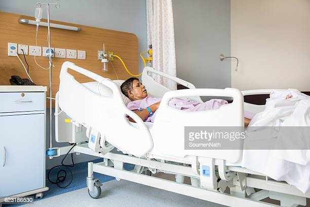 Old woman on Hospital bed, Oxygen tubes in her nose