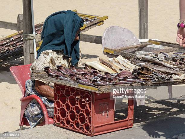 Old woman selling dried fish in Nazaré Portugal