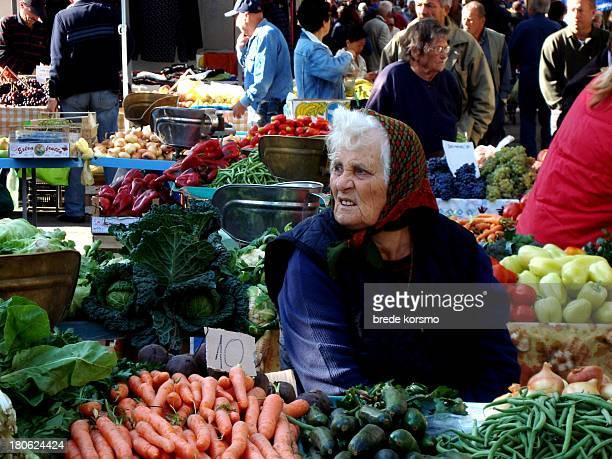 Old woman selling vegetables in market in Split, Croatia, September 18, 2008