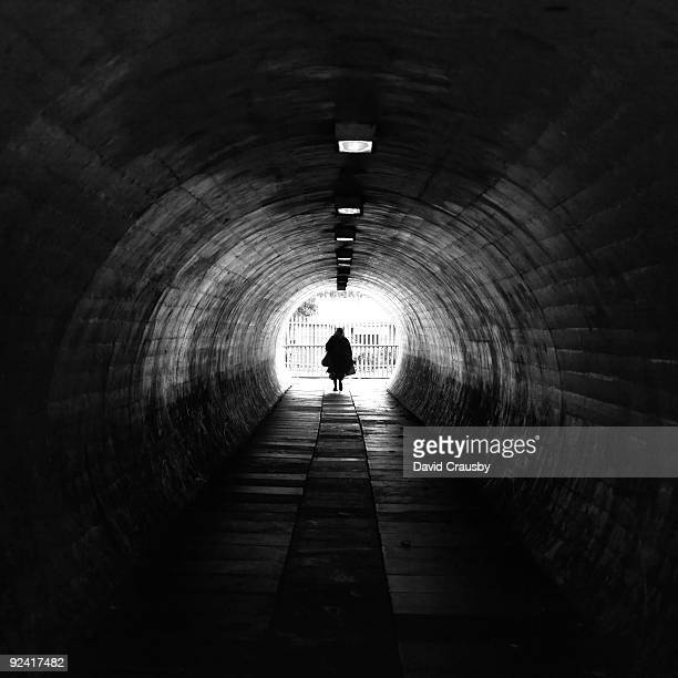 old woman silhouette in  subway tunnel - crausby stock pictures, royalty-free photos & images