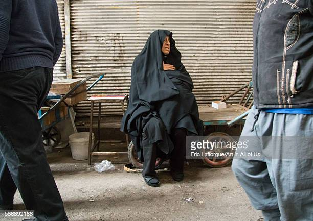 Old woman sitting on a bench in the bazaar central district tehran Iran on December 20 2015 in Tehran Iran