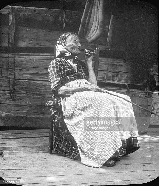 Old woman smoking a pipe Appalachia USA c1917 Photograph taken during Cecil Sharp's folk music collecting expedition British musician Sharp and his...