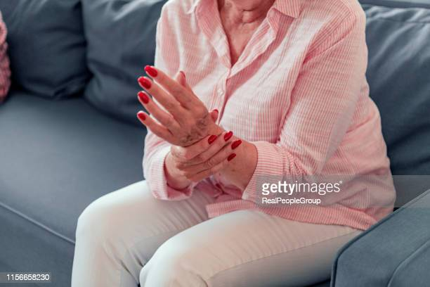 old woman suffering from pain and rheumatism - reflexology stock pictures, royalty-free photos & images