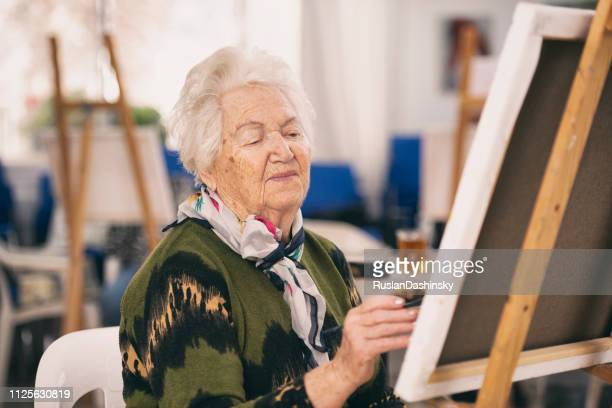 old woman taking an art class. - israeli woman stock pictures, royalty-free photos & images
