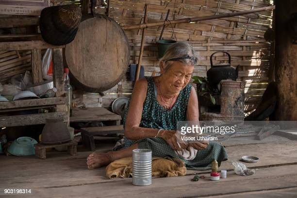 old woman using a smartphone. - it is finished stock pictures, royalty-free photos & images