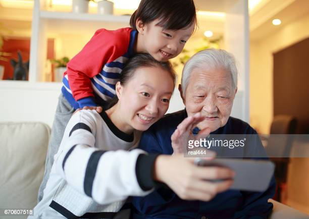 Old Woman Using mobile phone