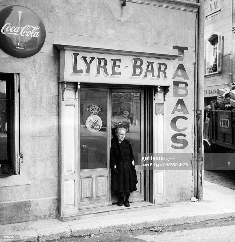 Old Woman In Front Of A Door Bar, Martigues, Bouches Du Rhone, France : News Photo