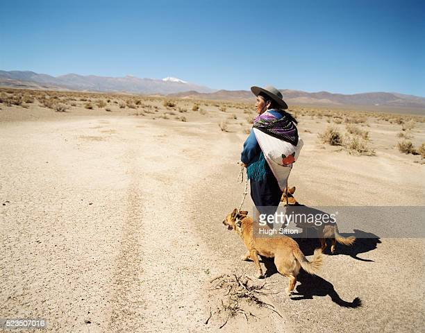 Old Woman Walking Dogs in the Jujuy Desert, Salta Area, Argentina