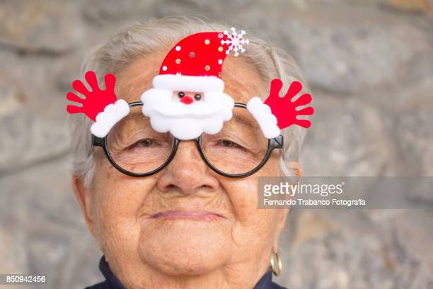 old woman with christmas glasses