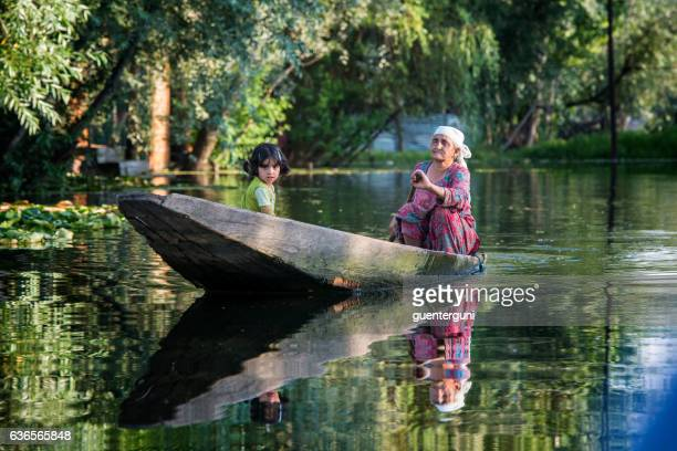 old woman with girl in a boat, lake dal, india - jammu and kashmir stock pictures, royalty-free photos & images
