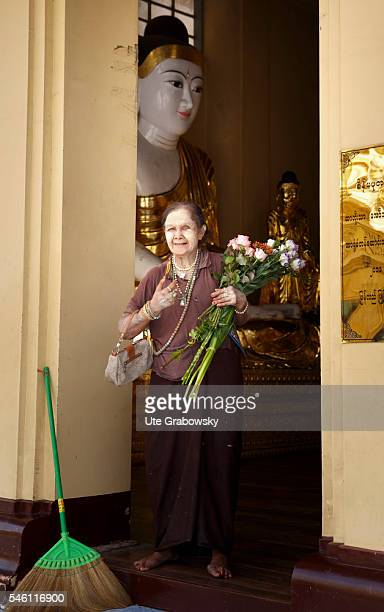 Old woman with traditional paste in the Shwedagon Pagoda in Yangon on June 16 2016 in Yangon Myanmar