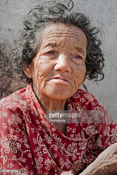 old woman with wrinkles - mongolian women stock photos and pictures
