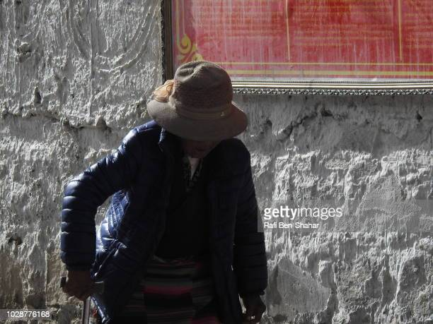 old woman worship in the entrance to the pelkhor chode temple - chode images stock photos and pictures