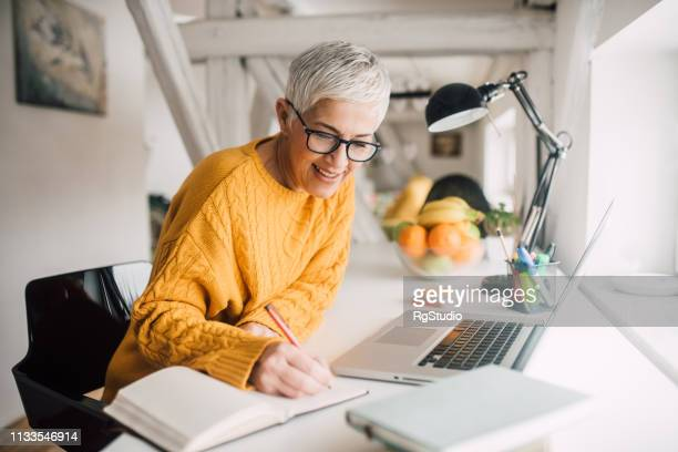 old woman writing - writing stock pictures, royalty-free photos & images