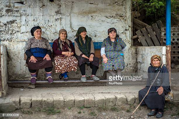 Old women meet on the bus stop to talk in Gil village Qusar district Azerbaijan on 6 October 2016