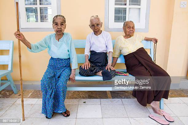 Old women sitting on a bench at a nursing home, Mingun, Sagaing Region, Myanmar, Asia