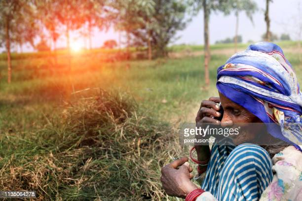 old women using smart phone - salwar kameez stock pictures, royalty-free photos & images