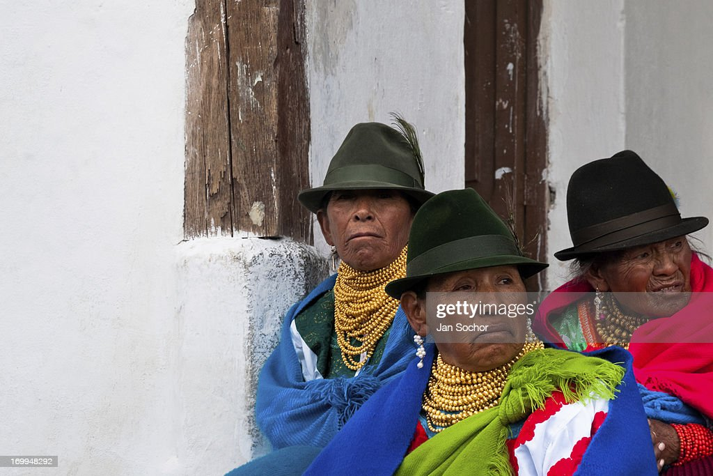 "Old women, wearing colorful clothes, watch a procession during the Inti Raymi celebration on 26 June 2010 in the village of Pesillo, Ecuador. Inti Raymi, ""Festival of the Sun"" in Quechua language, is an ancient spiritual ceremony held in the Indian regions of the Andes, mainly in Ecuador and Peru. The lively celebration, set by the winter solstice, goes on for various days. The highland Indians, wearing beautiful costumes, dance, drink and sing with no rest. Colorful processions in honor of the God Inti (Sun) pass through the mountain villages giving thanks for the harvest and expressing their deep relation to the Mother Earth (Pachamama)."