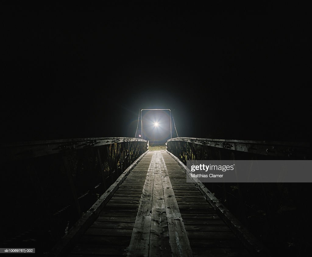Old wood bridge with mysterious light at night : Stock-Foto