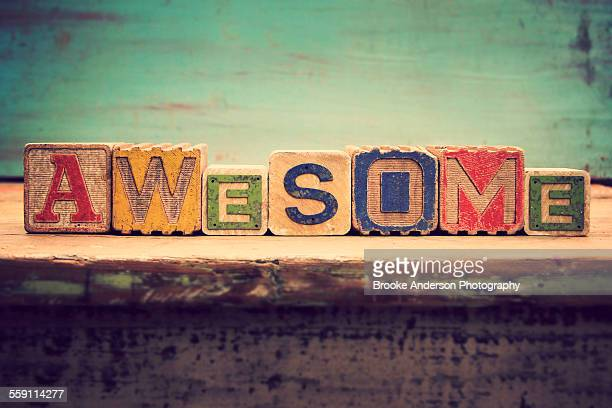"Old wooden alhpabet blocks that spell ""Awesome"""