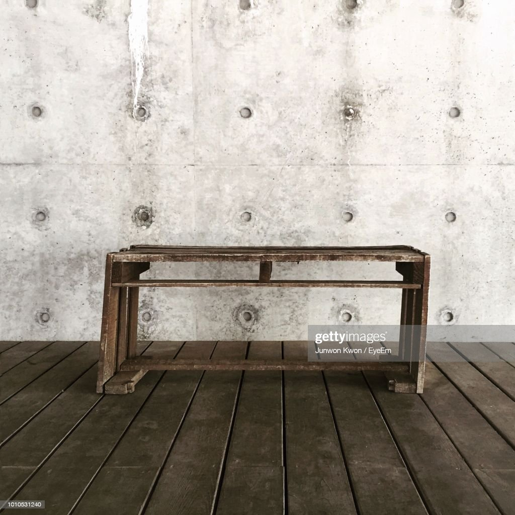 Sensational Old Wooden Bench Against Wall High Res Stock Photo Getty Onthecornerstone Fun Painted Chair Ideas Images Onthecornerstoneorg