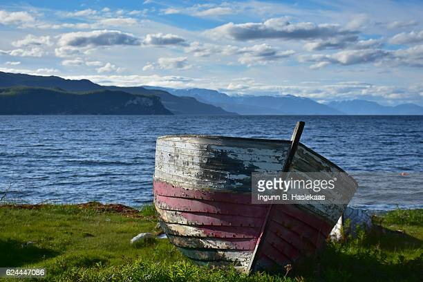 Old wooden boat by the sea. Summer in Northern Norway.