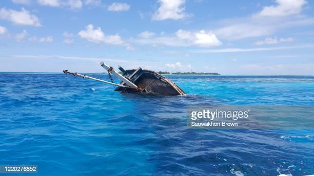 old wooden boat sank in the deep sea in maldives - sunken stock pictures, royalty-free photos & images