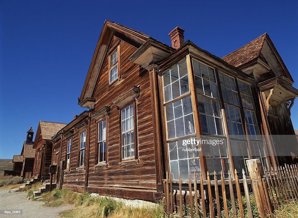 old wooden buildings in the ghost town of bodie california are seen in the noon sun : Stockfoto